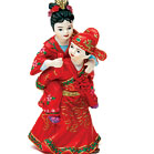 Cute Asian Couple in Traditional Wedding Attire made of hand painted porcelain. A caketop with a lot of character!